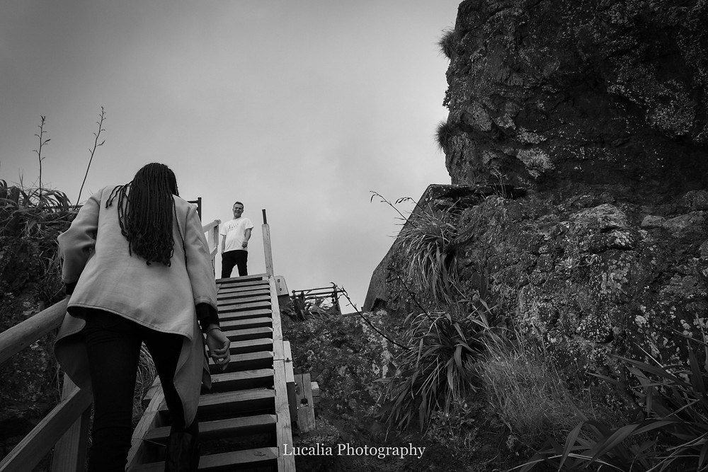 groom to be watching his bride walk up the stairs to Cape Palliser lighthouse, Wairarapa