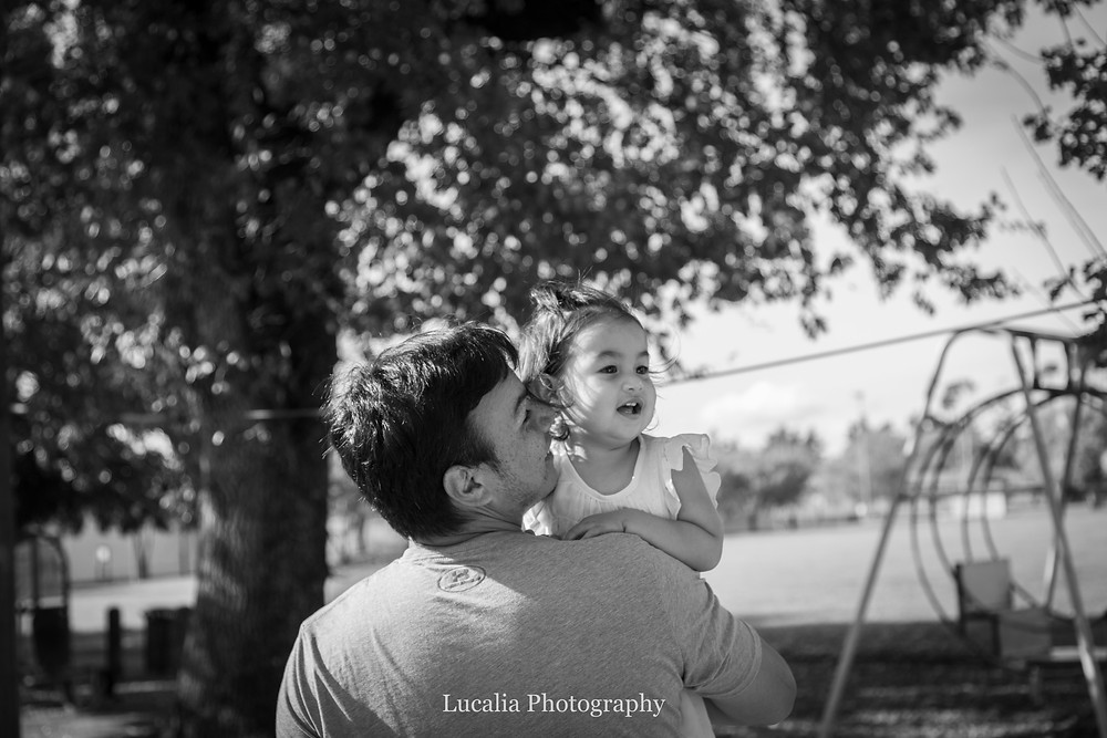 dad holding daughter in his arms, Carterton, Wairarapa family photographer