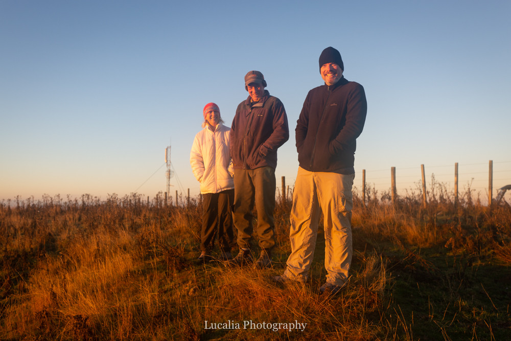 three people watching the sunrise at High Peaks Farm Stay, Mangamahu, Manawatu-Wanganui, New Zealand