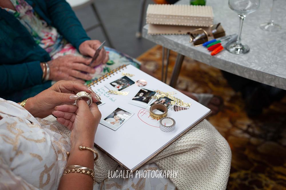 wedding guests decorating polaroid photo book at reception, Waimeha Bar and Grill, Ngawi Wairarapa wedding photographer