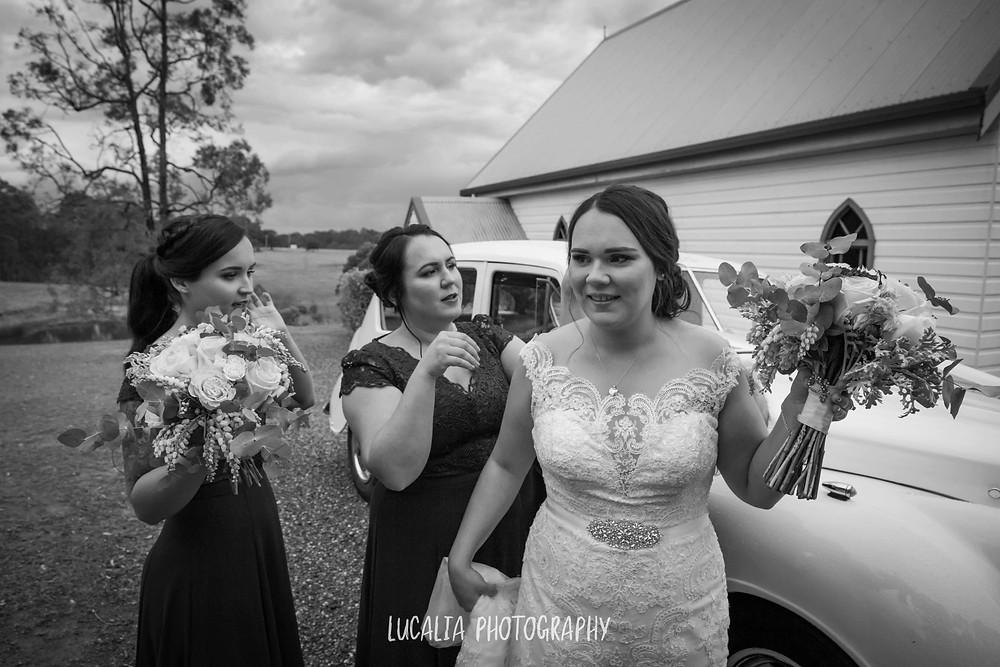 bride and her bridesmaids outside with vintage wedding car, Wairarapa wedding photographer