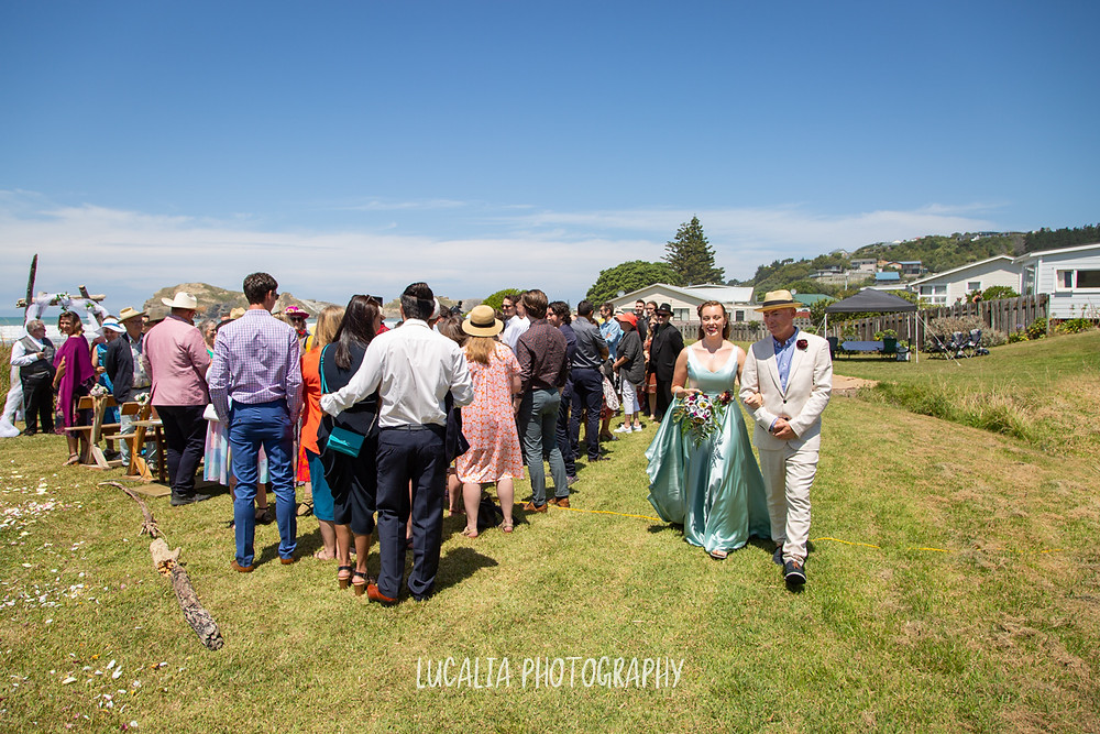 bride walks down the aisle with her father, Castlepoint Wairarapa wedding, Lucalia Photography
