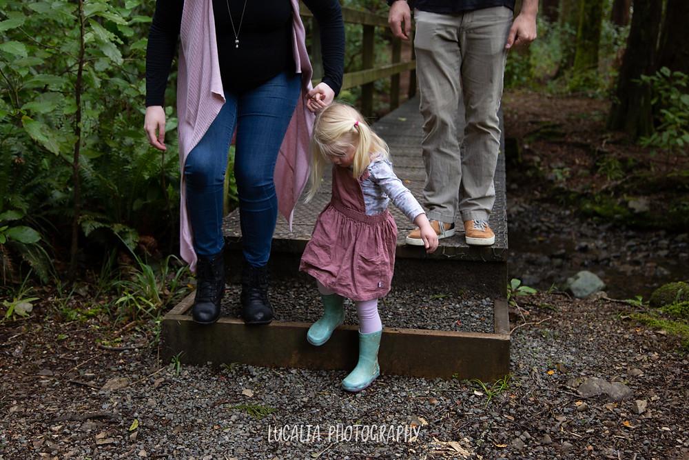girl holding mum's hand walking down steps at Kiriwhakapa forest, Wairarapa family photographer