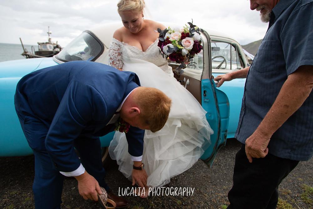 groom helping bride put on her Lulu Avarcas wedding shoes, Ngawi Wairarapa wedding photographer