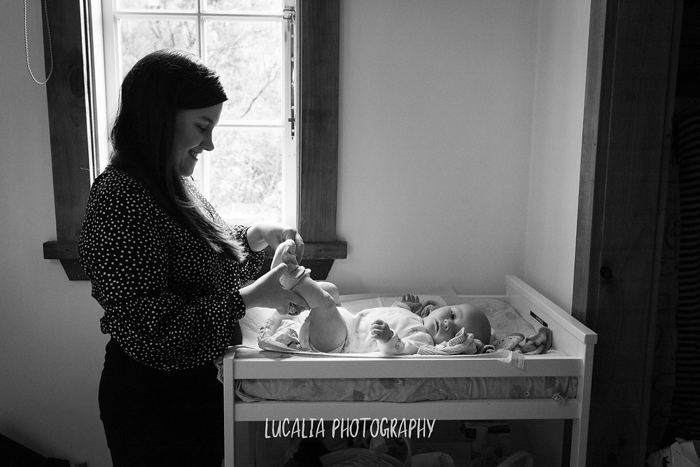 mother putting socks on son, Mount Holdsworth, Wairarapa family photographer