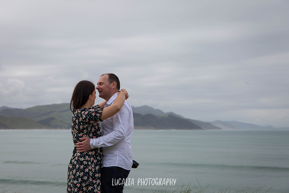 engaged couple kissing at Castlepoint, Lucalia Photography Wairarapa wedding photographer