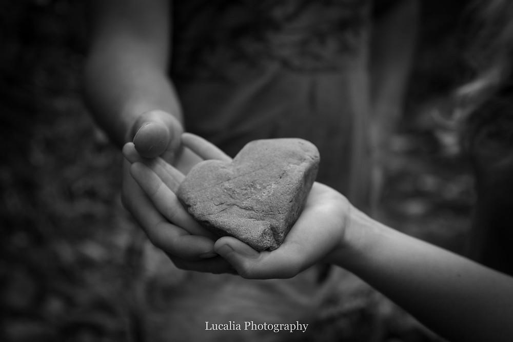 engaged couple with heart shaped rock, Featherston Wairarapa