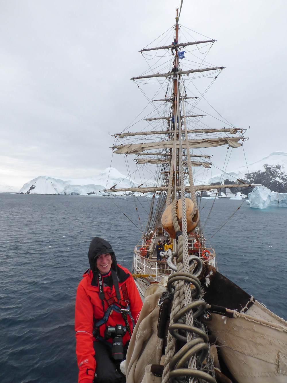 photographer on the bow of a ship with icebergs in Antarctica, Wairarapa wedding photographer