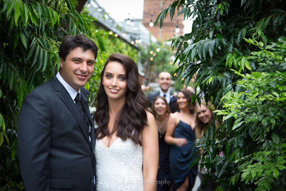 bride and groom portrait in trees with fun bridal party, Lucalia Photography