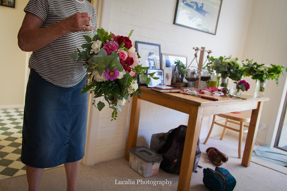 finishing a wedding bouquet, Wairarapa wedding photographer