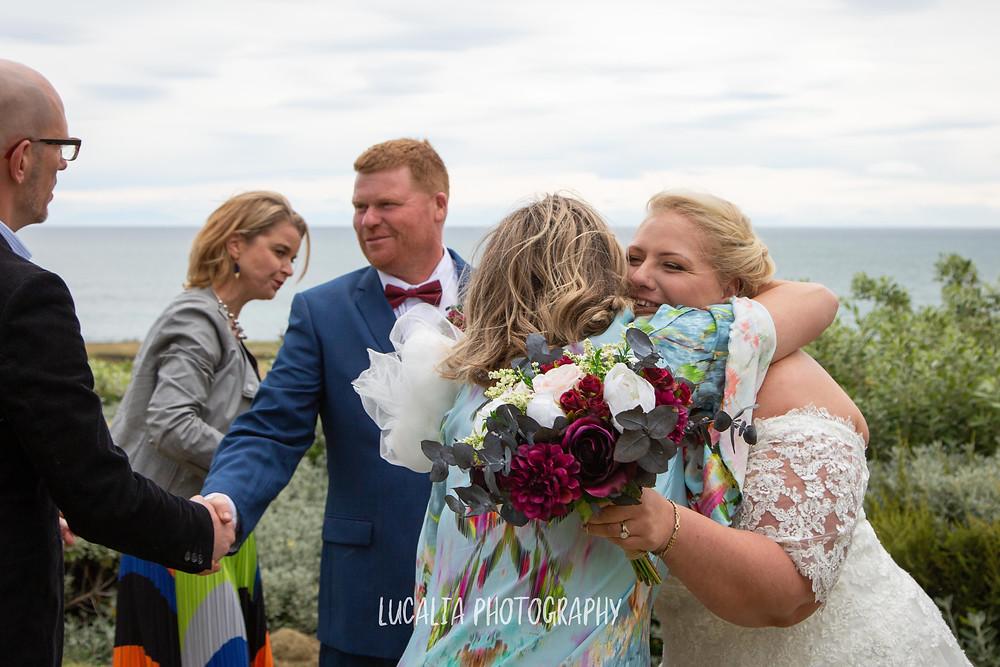 newly weds hugging wedding guests, Waimeha Camping Village wedding venue, Ngawi, Wairarapa wedding