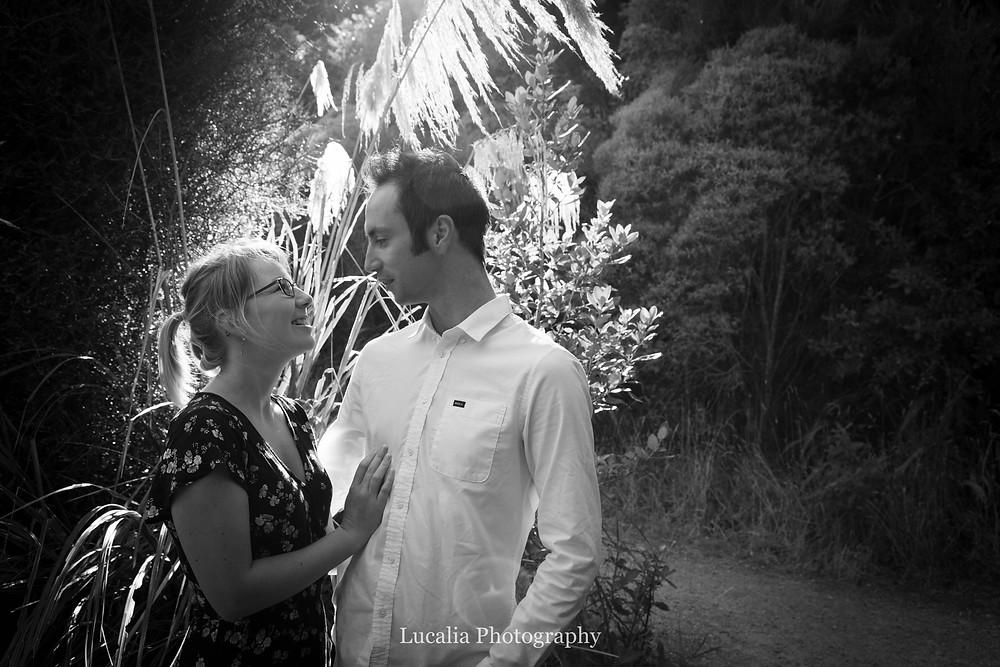 engaged couple in front of native toe toe, Zealandia, Wellington