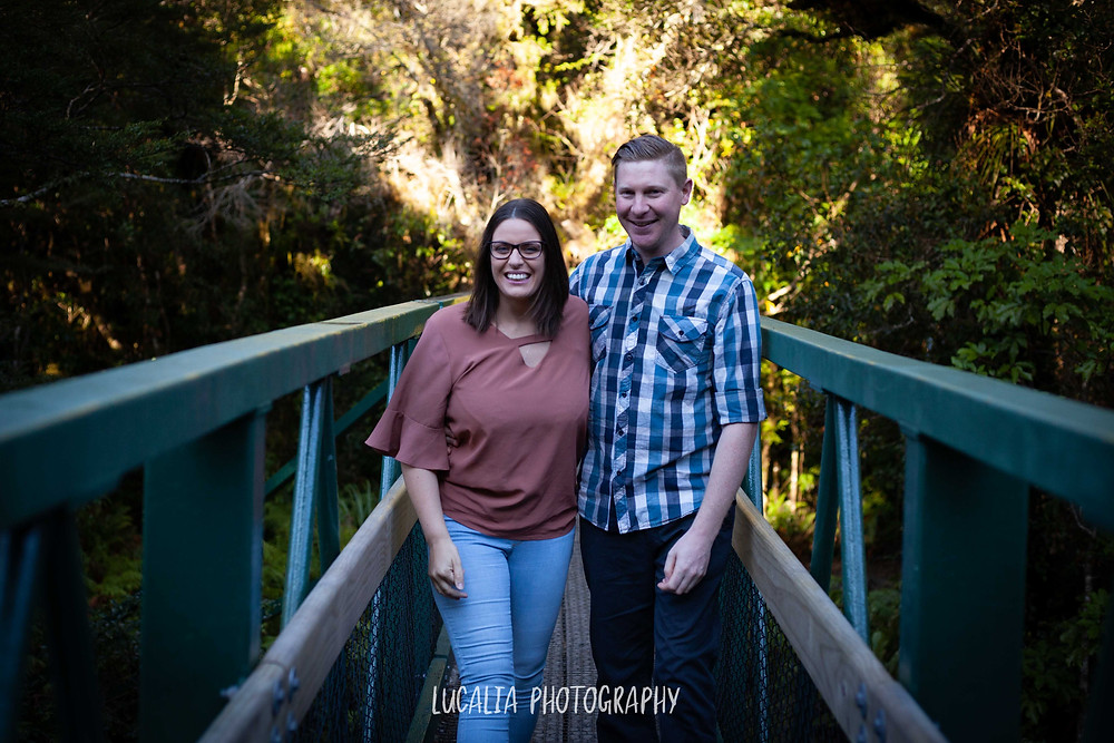 couple walking forward on green bridge, Mt Holdsworth, Wairarapa wedding photographer