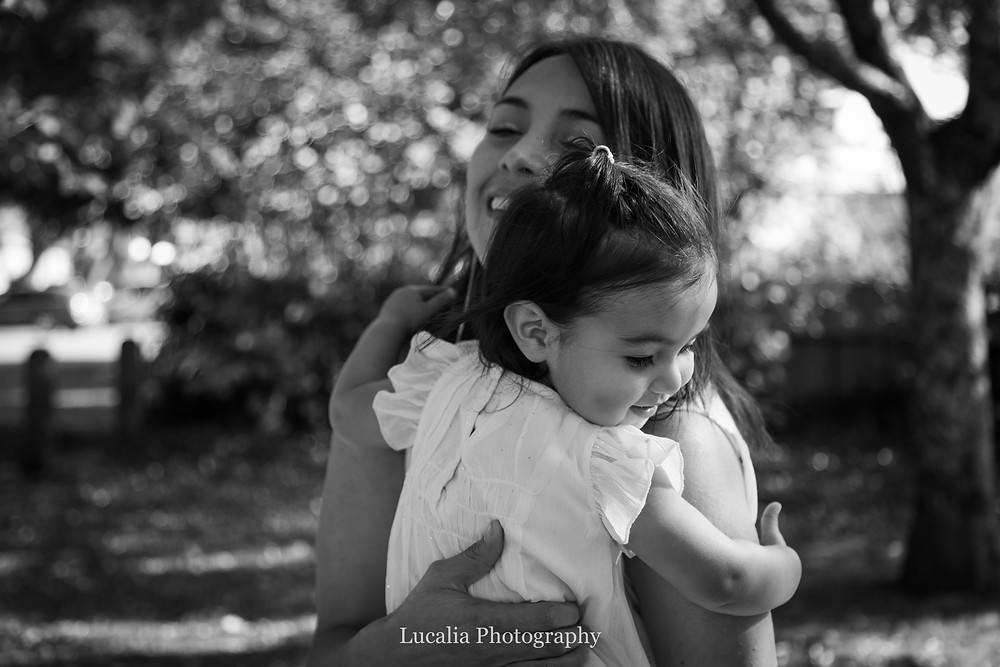 mum holding daughter in Autumn light, Carterton, Wairarapa family photographer