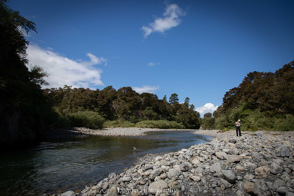 Mum and baby on the banks of a river, Tararua Forest Park, Wairarapa family photographer