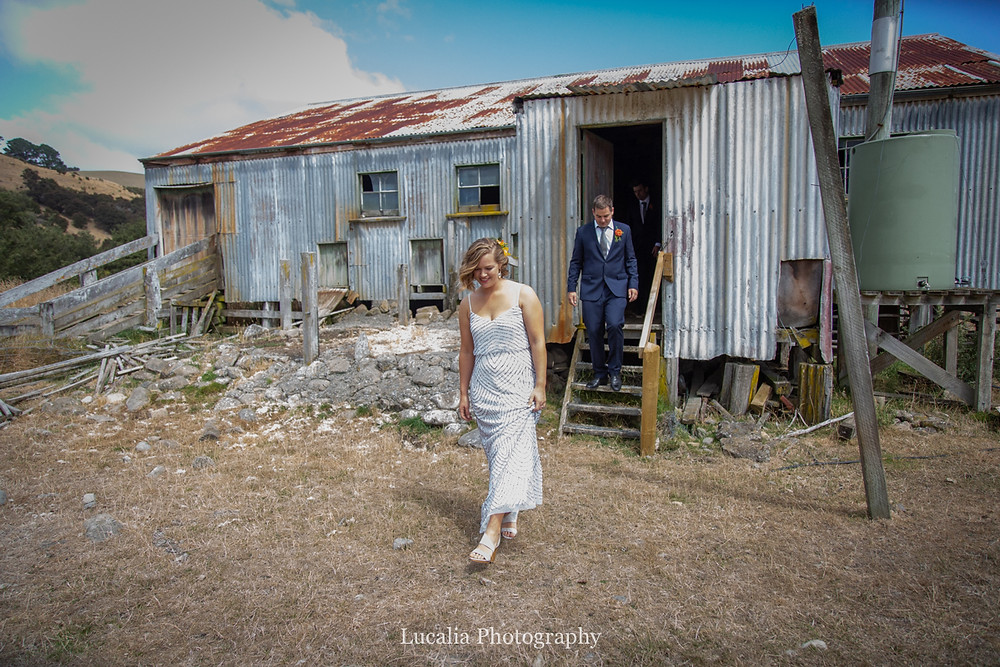 bride and groom walking out of rustic woodshed, Wairarapa wedding photographers