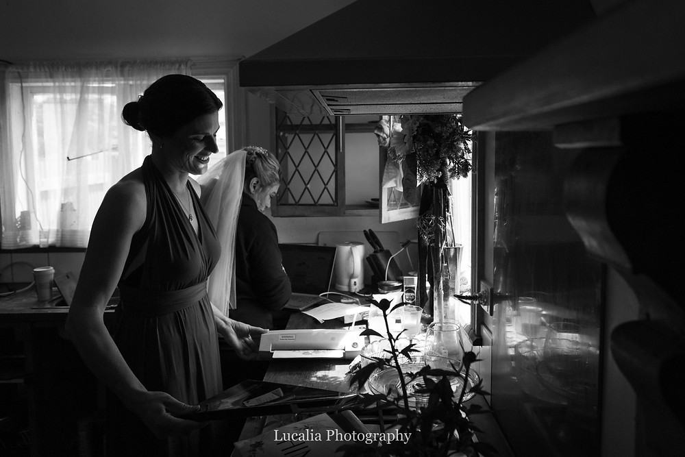 bride and bridesmaid illuminated by kitchen window light, Wairarapa wedding photographer
