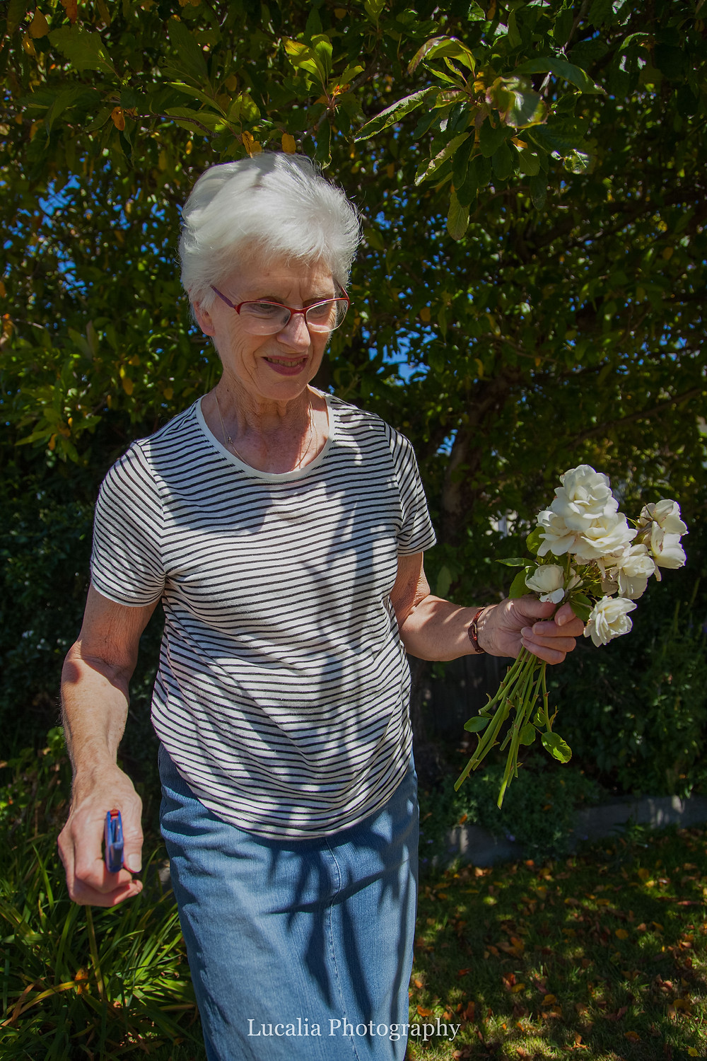 mother of the bride holding cut flowers, Wairarapa wedding photographer