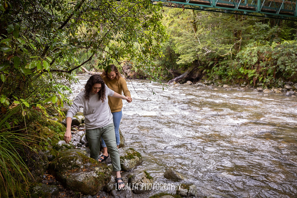couple walking along river edge Tararua Forest Park, Lucalia Photography, Wairarapa wedding photographer