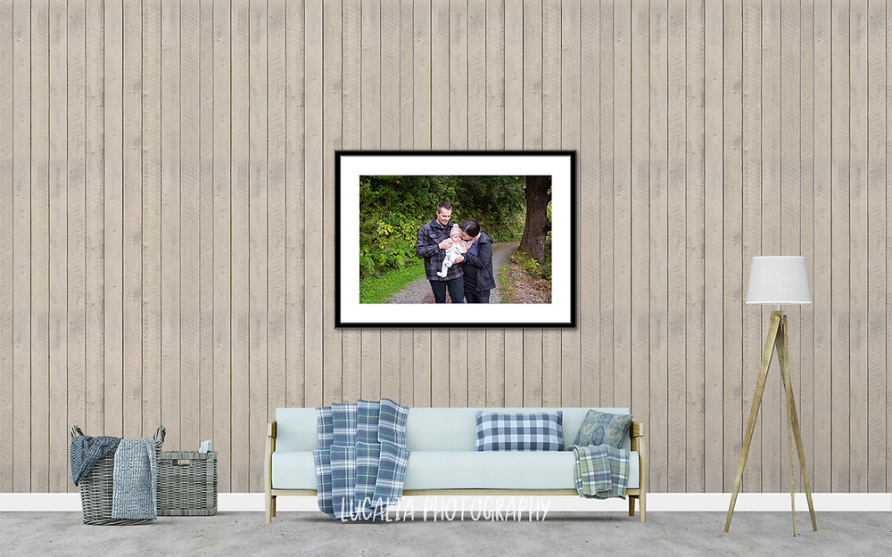 framed photos of mum and dad kissing baby on forest road, Mount Holdsworth, Wairarapa family photographer