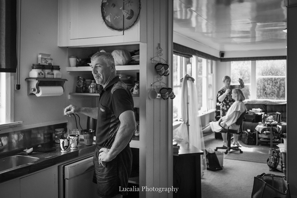 uncle makes cup of tea whilst bride has hair done, Wairarapa wedding photographers