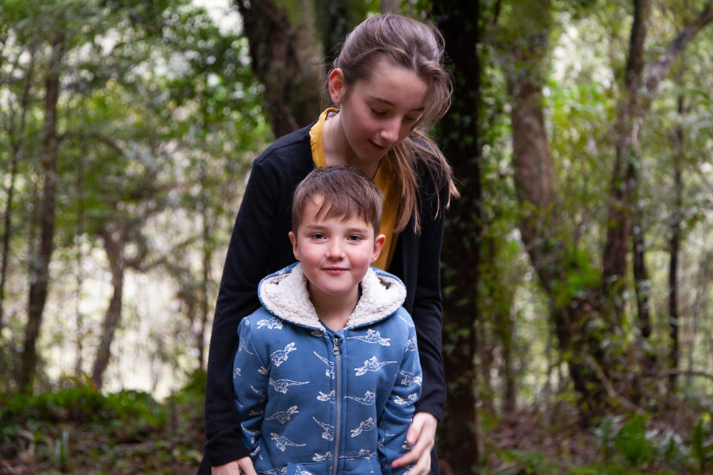 brother and sister hugging in forest, Waiohine Gorge, Wairarapa family photographer