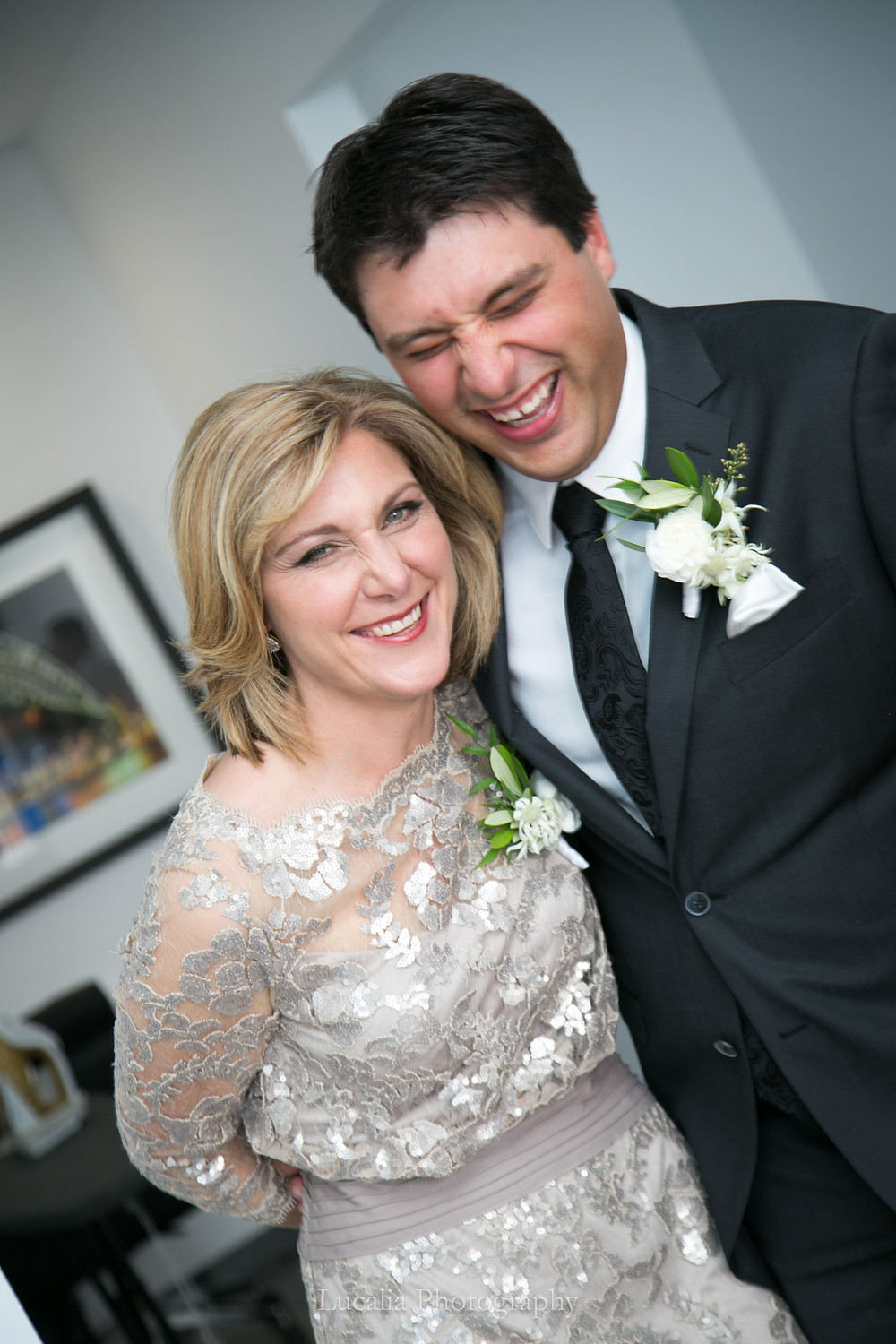 groom laughing with his mum