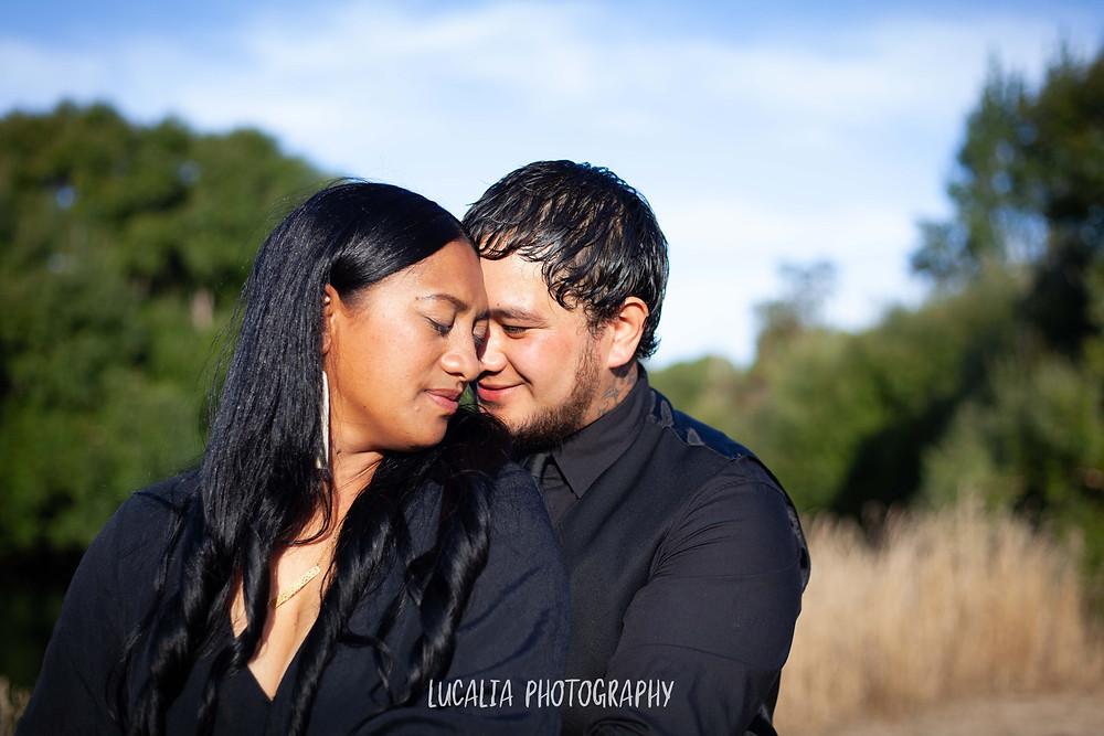 engaged couple touching heads, Wairarapa wedding photographer