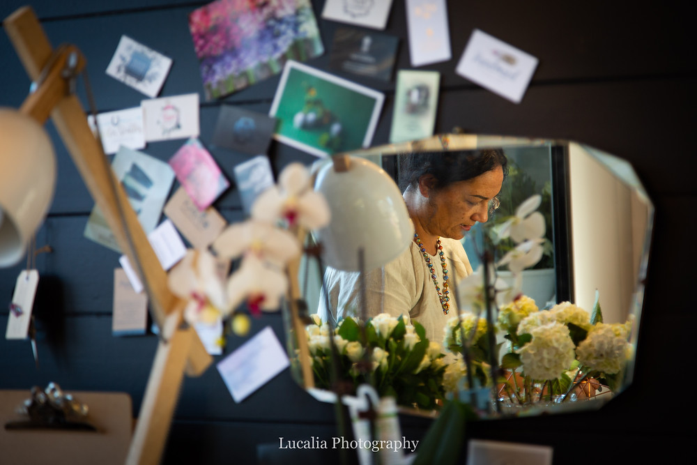Narida Hooper Martinborough wedding florist reflected in a vintage mirror, Wairarapa
