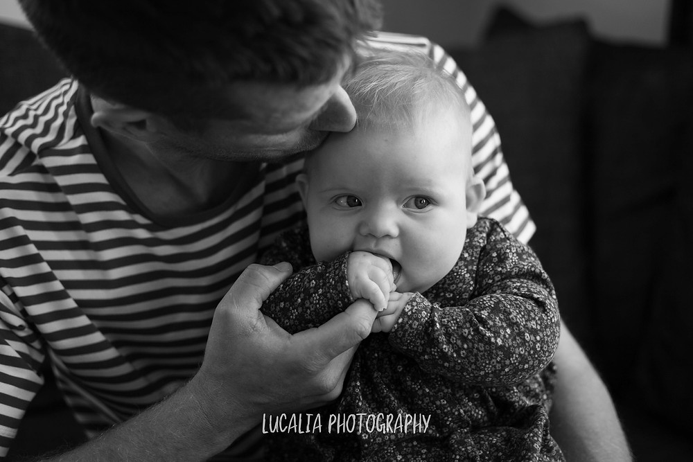 dad kissing daughter's head, Wairarapa family photographer
