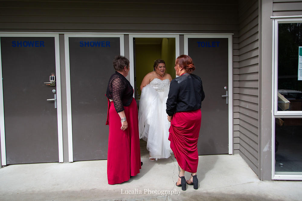 bride coming out of the toilets, Wairarapa wedding photographer