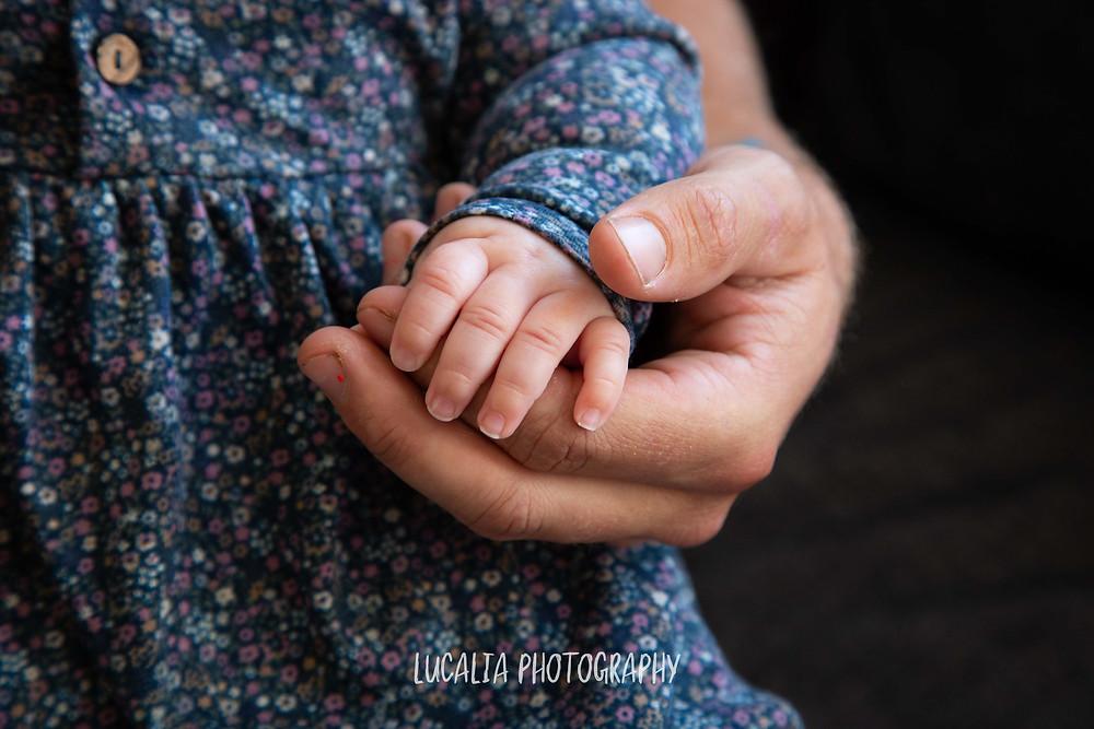 baby girl holding her mum's fingers, Wairarapa family photographer
