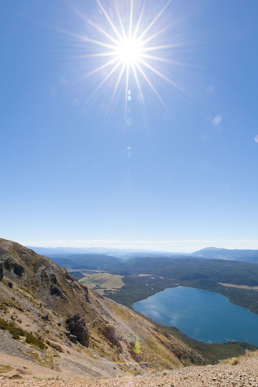 Hiking to the peak of Mount Robert in Nelson Lakes National Park on a New Zealand honeymoon