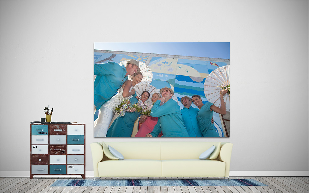 large canvas print of bridal party hanging above a couch in a loungeroom