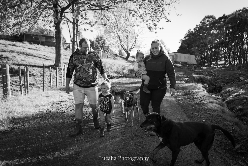 family walking in golden light on a gravel road, Wairarapa family photographer