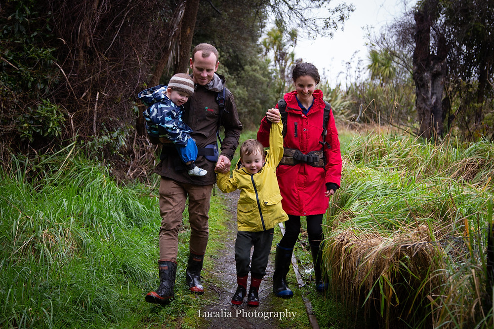 a family walking and smiling in the bush, Wairarapa family photographer