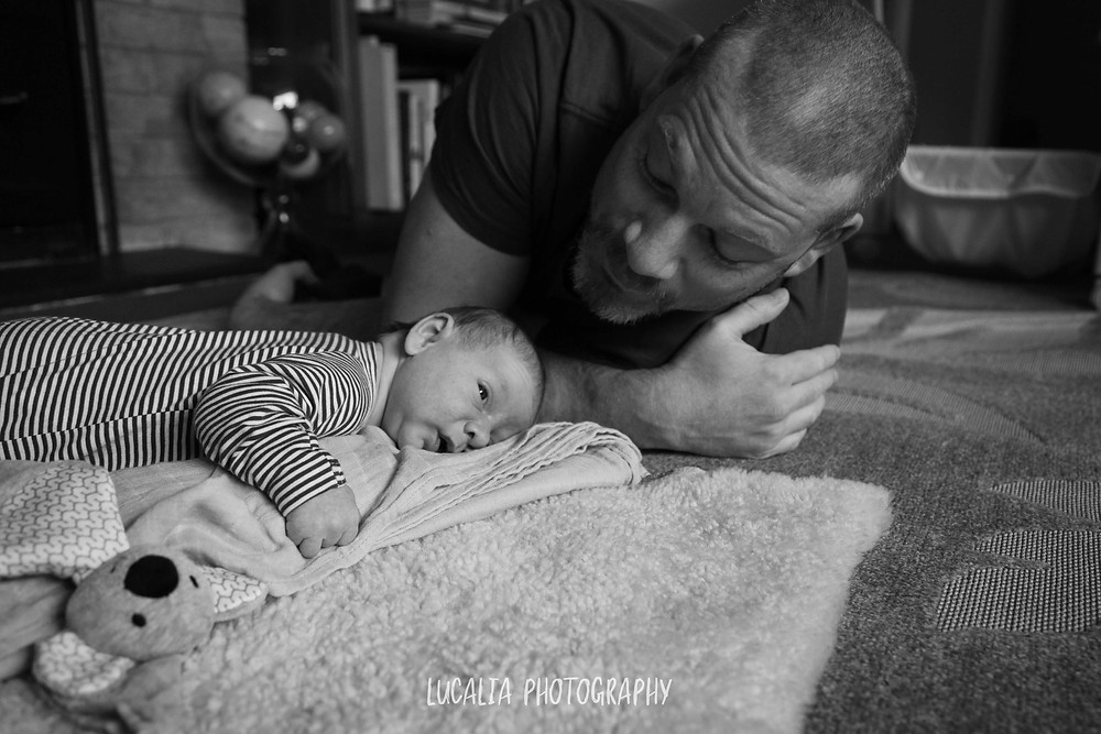 Dad and baby playing on the floor, Wairarapa newborn photographer