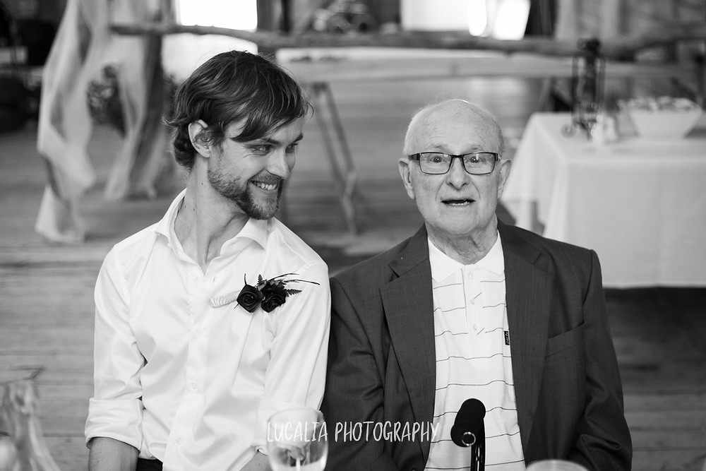 groom looking at his grandfather during wedding reception, Castlepoint Wairarapa wedding, Lucalia Photography