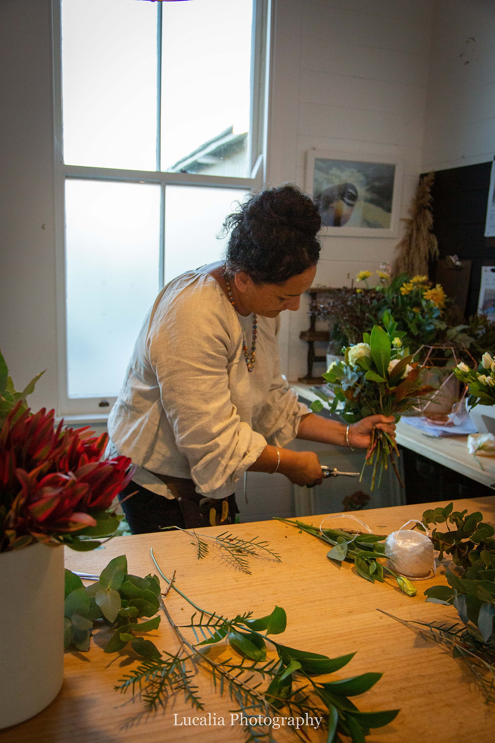 trimming the stems in a Wairarapa wedding florist