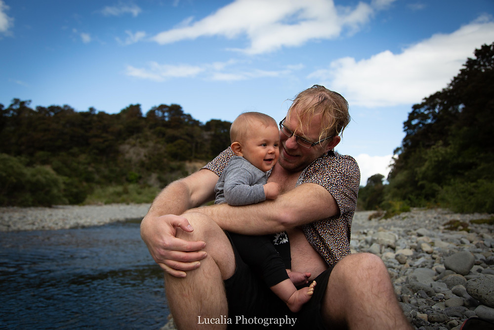 dad holding 6 month old baby laughing, Tararua Forest Park, Wairarapa family photographer