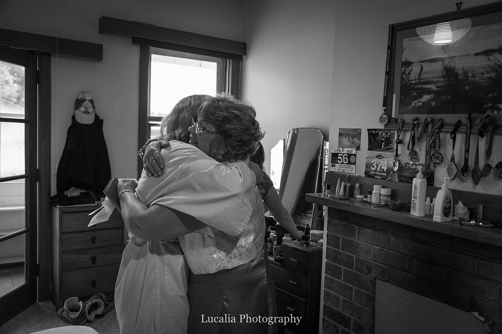 mother hugging bride on her wedding day, Wairarapa wedding photographers