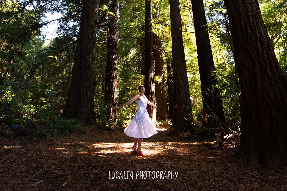 Wairarapa wedding celebrant Aingie Miller dancing in the light at Pūkaha National Wildlife Centre
