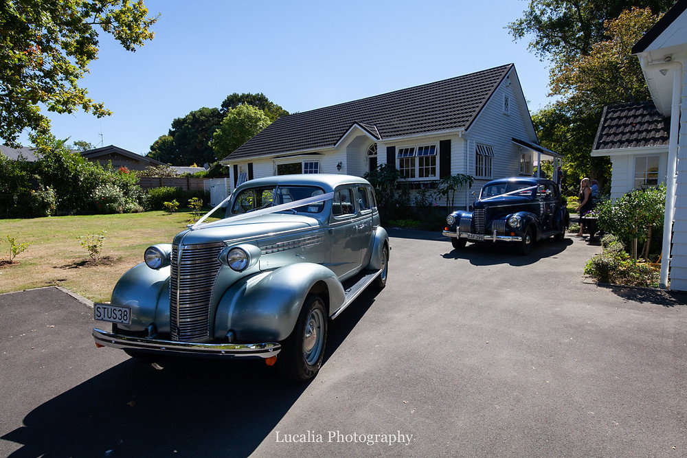 wedding cars leaving country cottage, Wairarapa