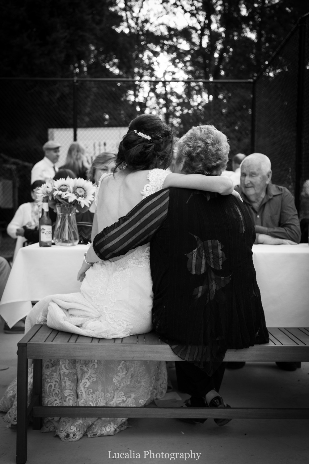 bride with arms around a wedding guest, Wairarapa wedding photographer