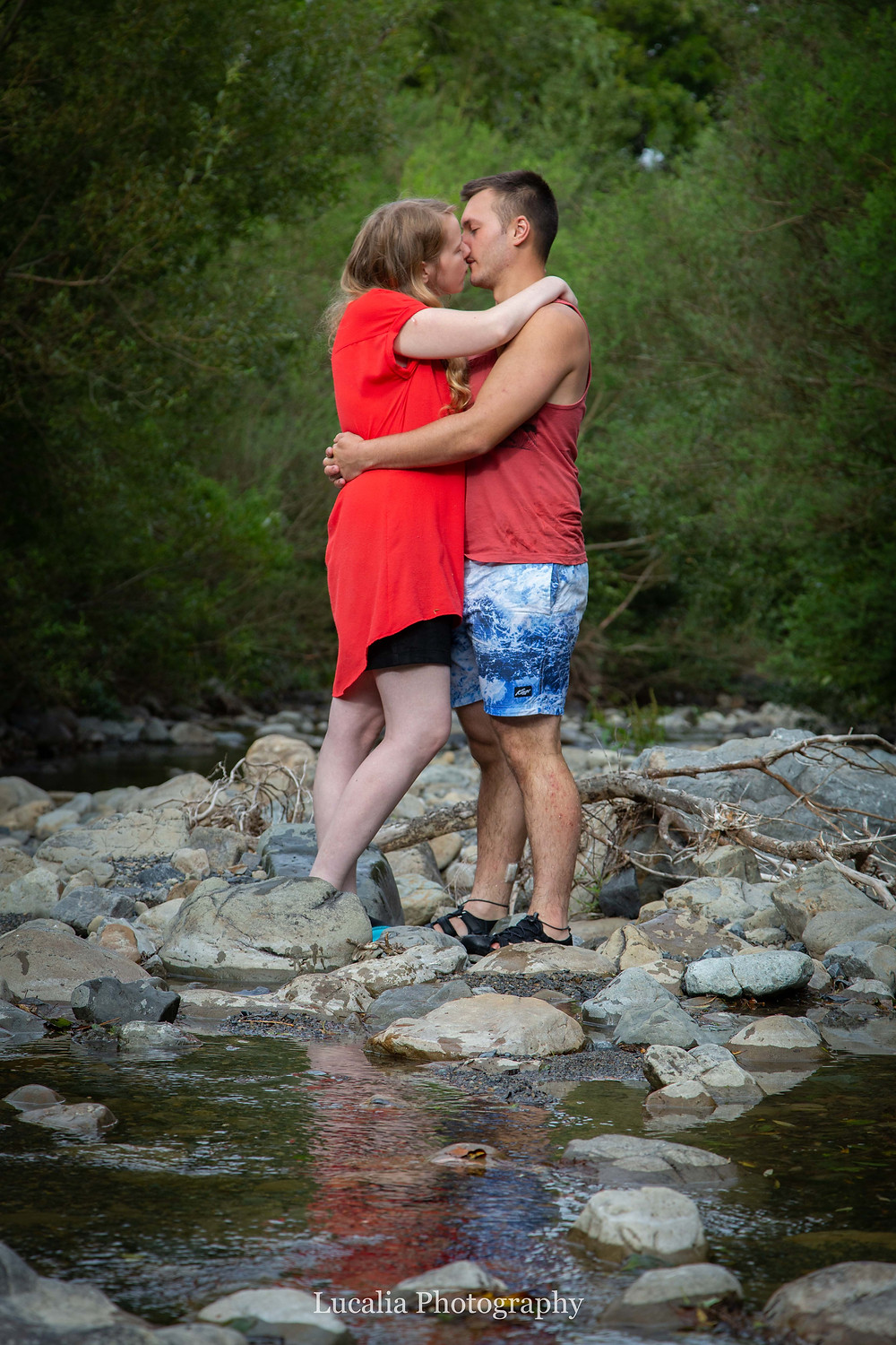 engaged couple kissing in a river, Featherston Wairarapa