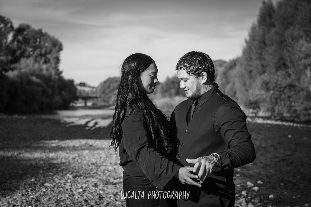 engaged couple on river bank, Wairarapa wedding photographer