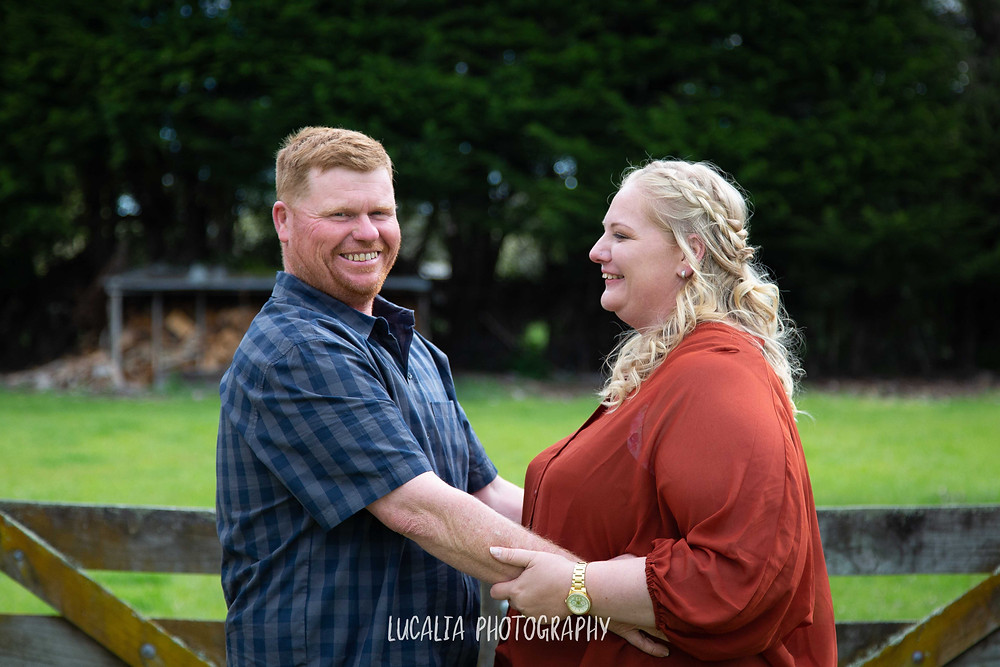 engaged couple groom looking at camera, Wairarapa wedding photographer