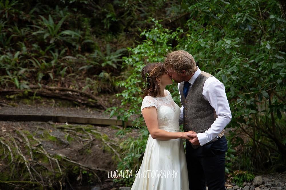 couple kissing in a forest, Kiriwhakapapa Wairarapa wedding photographer