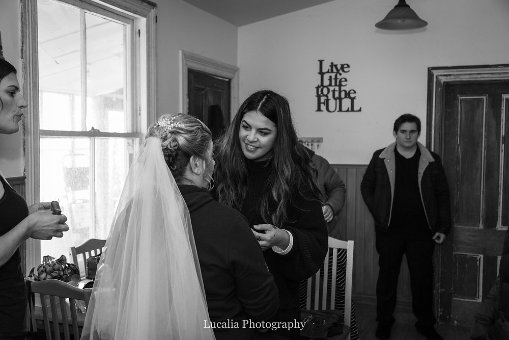 bride getting her makeup done with her son looking on, Wairarapa wedding photographer