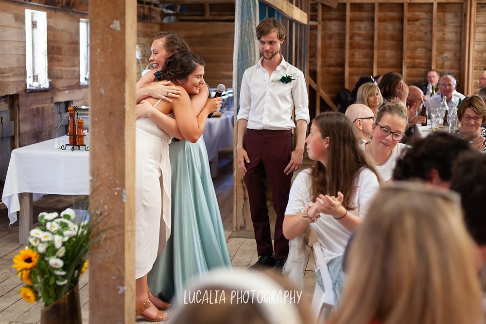 hugs after speeches, Castlepoint Wairarapa wedding, Lucalia Photography
